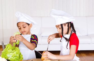 Siblings making sandwich